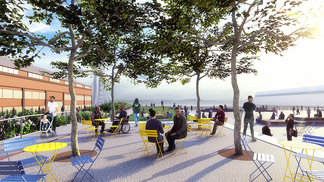 Members of the public stand and sit among trees overlooking Puget Sound
