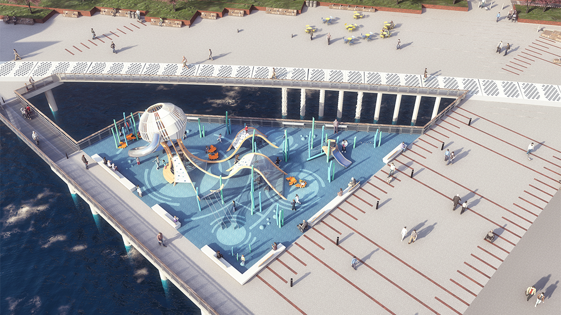 The playground with the Jellyfish structure is surrounded by open water edge on the left side. The right side is an open plaza area with seating. There are children playing at the playground with parents sitting on the benches along the edges of the playground.