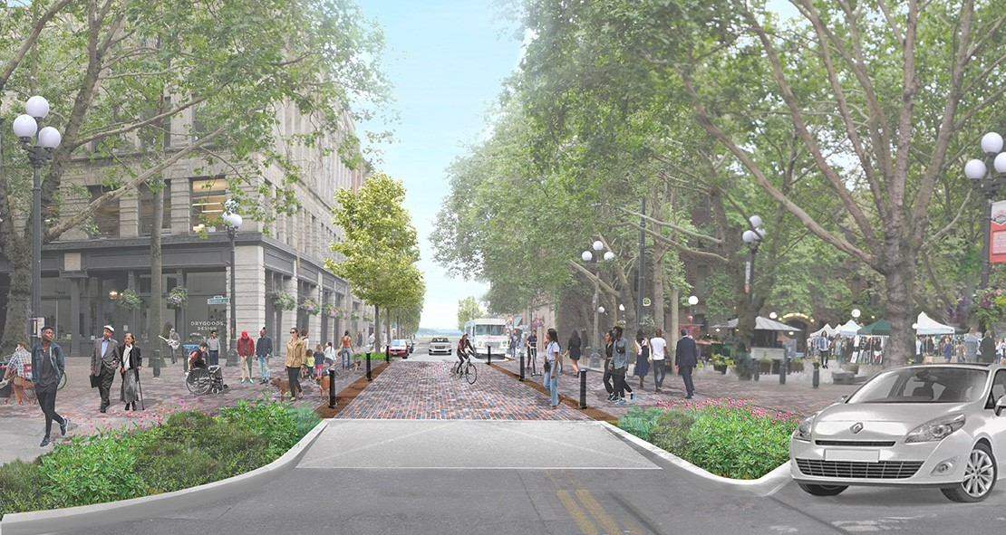 Design rendering showing people in Occidental Park crossing Main Street at an intersection that is raised a few inches above the street to encourage cars to prioritize pedestrians, with trees and greenery around.