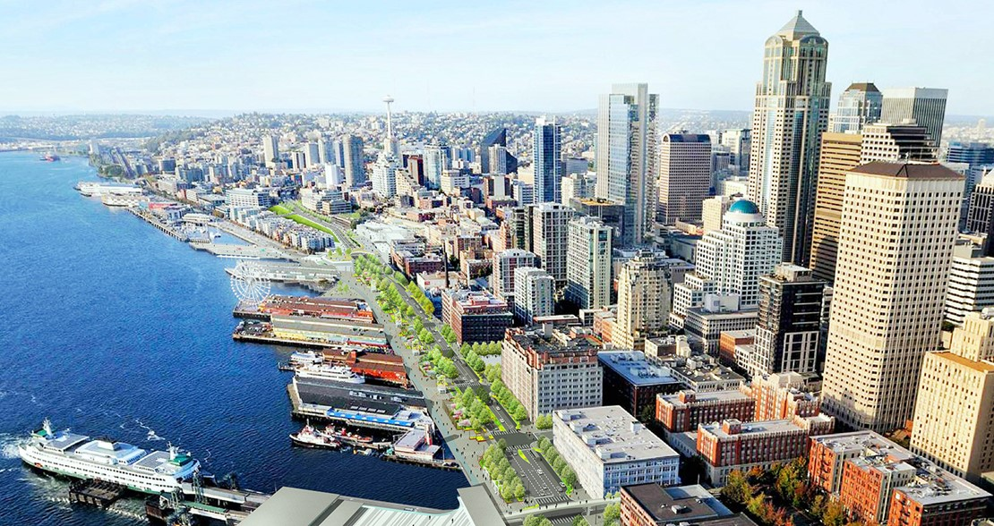 A rendering shows green space and a multimodal road spanning the Seattle waterfront with the Colman Dock ferry terminal in the foreground and the skyline in the background.