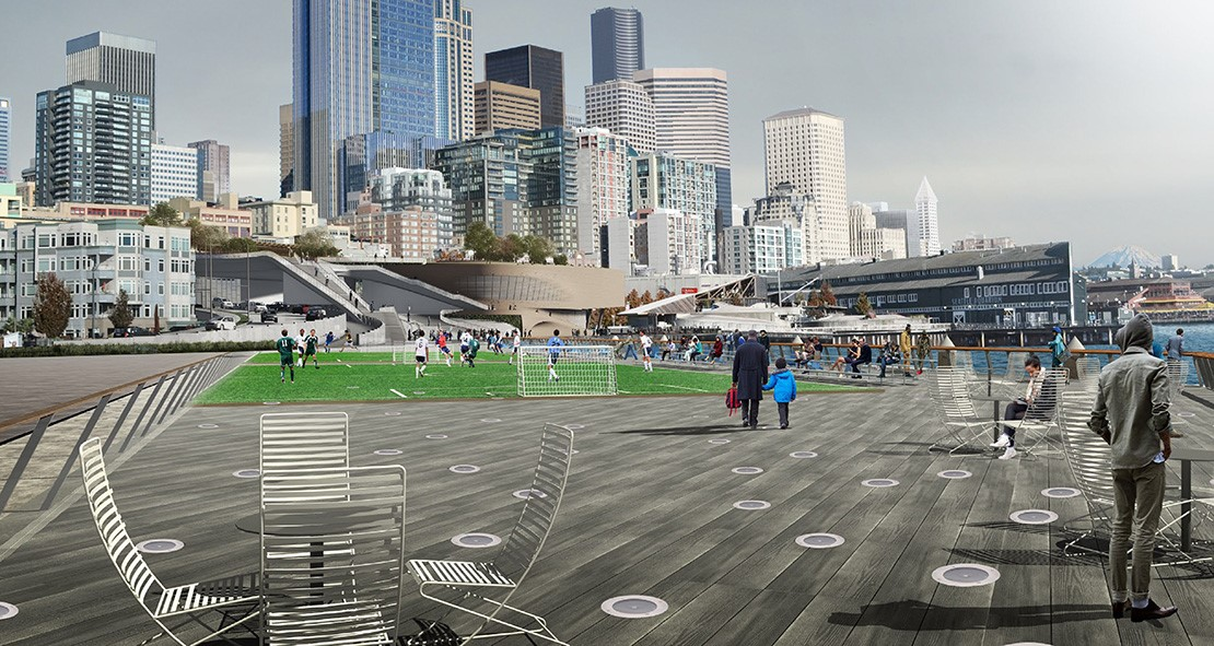 Design rendering of Pier 62 facing west towards the city, with people playing soccer on a temporary field and other people sitting at outdoor tables