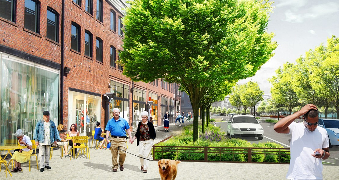 Rendering of people walking down a pedestrian sidewalk on a sunny day. Trees and shrubs protect pedestrians from the road.