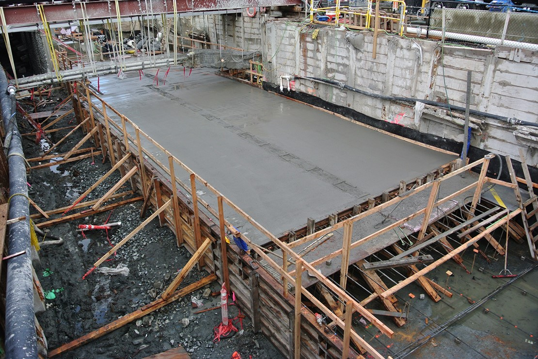 Photo of a poured concrete slab curing.