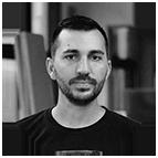 Black and white headshot of artist Derek Bruno.